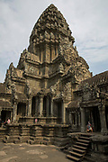 An ancient tower of Angkor Wat in the temple complex of Angkor Wat Siem Reap, Cambodia.  Angkor Wat is one of UNESCO's world heritage sites. It was built in the 12th century and is Cambodia's main tourist destination.