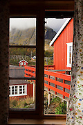 Traditional rorbu cabins overlooking the water in Å, Lofoten Islands, Norway.