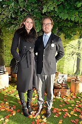 SABRINA PERCY and PHINEAS PAGE at the 2014 Hennessy Gold Cup at Newbury Racecourse, Newbury, Berkshire on 29th November 2014.  The Gold Cup was won by Many Clouds ridden by Leighton Aspell,