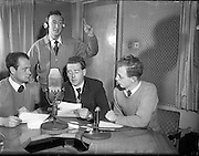 01/03/1956<br /> 03/01/1956<br /> 01 March 1956<br /> Radio Review special for Radio Eireann Junior Sports Magazine show. Pictured (l-r): Paul Dolan; Harry Thuillier; Leo Nealon and Fred Cogley at R.E. Studios.