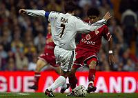 4/2/2004 Madrid, Spain.<br />Copa Del Rey (Spanish Cup) Semifinals. 1 Leg.<br />R.Madrid 2 - Sevilla 0<br />R.Madrid's Raul in duel with Sevilla's DAniel Alves at Santiago Bernabeu's Stadium.