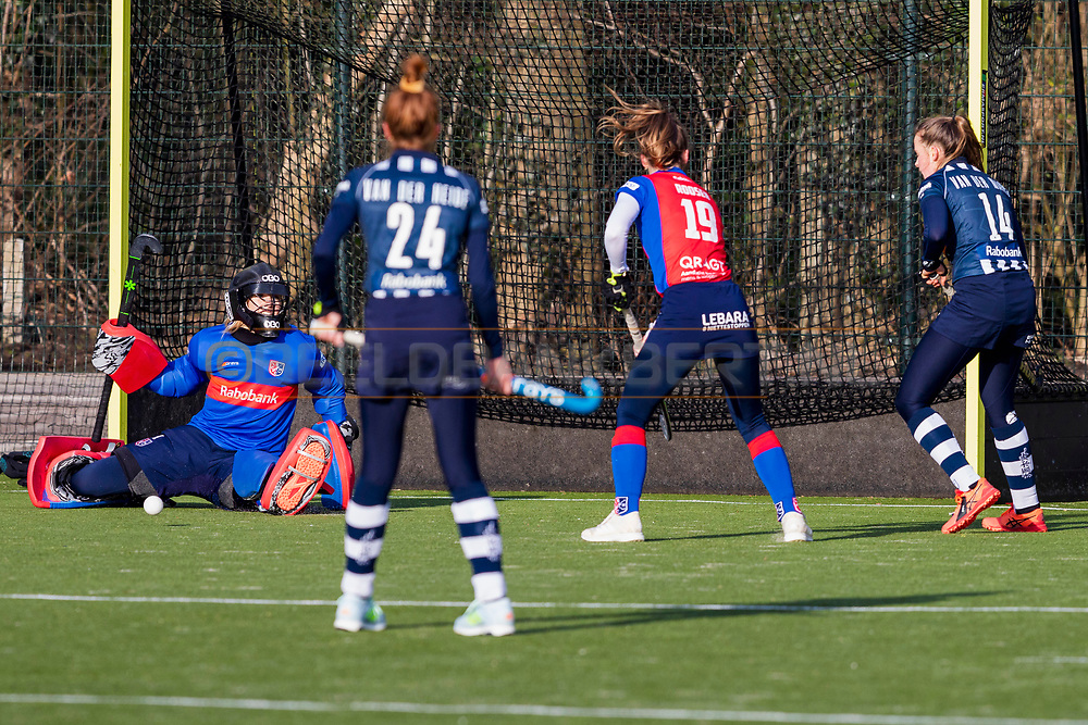 BILTHOVEN -  Hoofdklasse competitiewedstrijd dames, SCHC v hdm, seizoen 2020-2021.<br /> Foto: Redding keeper Alexandra Heerbaart (SCHC)