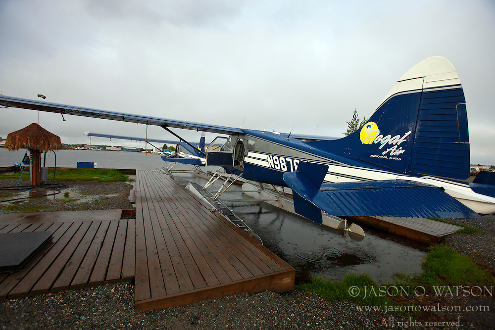 Float planes sit by a dock at Lake Hood, Anchorage, Alaska, United States of America
