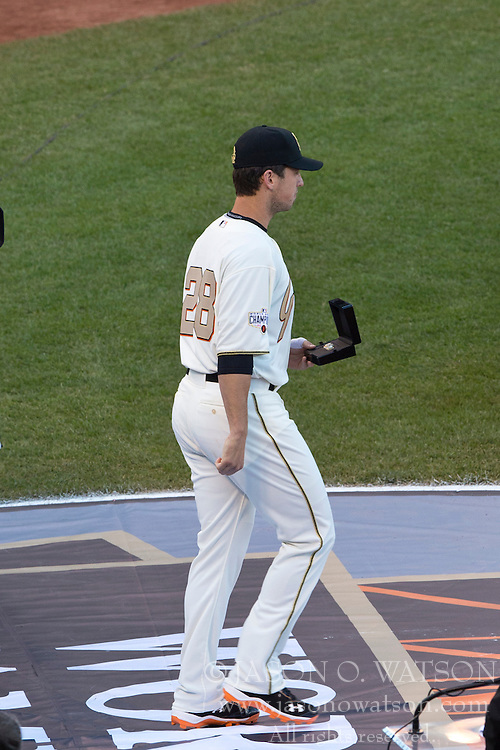SAN FRANCISCO, CA - APRIL 18:  Buster Posey #28 of the San Francisco Giants walks on to the field during the 2014 World Series ring ceremony before the game against the Arizona Diamondbacks at AT&T Park on April 18, 2015 in San Francisco, California.  The San Francisco Giants defeated the Arizona Diamondbacks 4-1. (Photo by Jason O. Watson/Getty Images) *** Local Caption *** Buster Posey