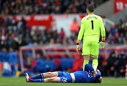 Everton's Tom Davies lies injured on the pitch