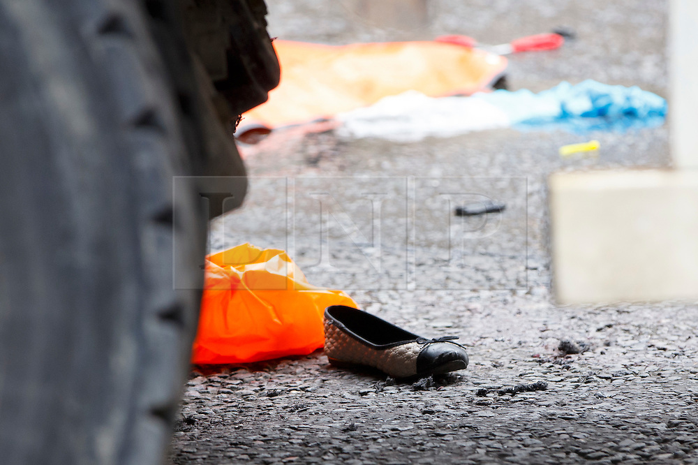 © Licensed to London News Pictures. 22/06/2015. London, UK. Shoes of a female cyclist who died in a crash with a tipper truck at Bank junction in London during morning rush hour on Monday, June 22, 2015. Photo credit: Tolga Akmen/LNP