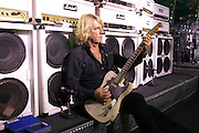 Ageing guitarist Rick Parfitt of Status Quo adjusts his Marshall Amplifier during sound check on European tour in Lille, France.