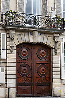 Ornate Paris Door - Thousands of doors and gates adorn buildings in Paris.  Some of the best are on government offices, cathedrals and churches, as well as a few chateau.  However, any self-respecting contractor with a decent budget probably spent a lot of consideration in installing suitable doors, windows, grill work and even doorknobs. Some of these gates, doors and windows are very simple, while others are extravagant works of art. The styles of these doors tell about the history of France. As you walk across the 20 arrondissements of Paris, you will discover Gothic, Renaissance, Haussmann and Art Nouveau door styles. It is up to you to take the time to look for little details of these Paris' most beautiful doors with statues, bas-reliefs, mascarons, gold-leaf, grills, handles and door knobs.