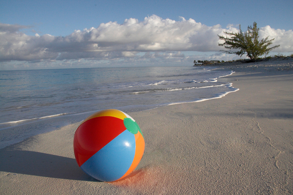 Forgotten beachball on Grace Bay, Providenciales beach near ocean's edge