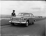 03/07/1961<br /> 07/03/1961<br /> 03 July 1961<br /> Irish Shell and Buckley's Motors, Humber Snipe car with Mr Pike who was chauffeur for the visit of Prince Rainier and Princess Grace of Monaco. Note the Monaco coat of arms affixed to the grill.