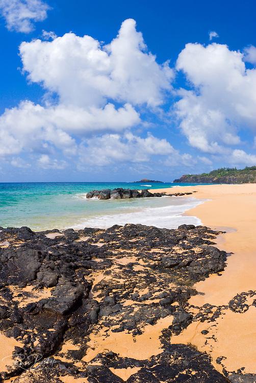 Surf and lava rock at Secret Beach, North Shore, Island of Kauai, Hawaii