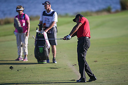 February 25, 2018 - Palm Beach Gardens, Florida, U.S. - Tiger Woods hits on the 18th hole during the final round of the 2018 Honda Classic at PGA National Resort and Spa in Palm Beach Gardens, Fla., on Sunday, February 25, 2018. (Credit Image: © Andres Leiva/The Palm Beach Post via ZUMA Wire)