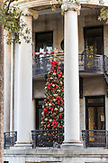 A Christmas tree on the porch of a historic home in Savannah, GA.