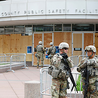 Minnesota Army National Guard soldiers stand guard outside the Hennepin County Public Safety Center before an arraignment hearing for three former Minneapolis police officers after a white police officer was caught on a bystander's video pressing his knee into the neck of African-American man George Floyd, who later died at a hospital, in Minneapolis, Minnesota, U.S. June 4, 2020. REUTERS/Adam Bettcher
