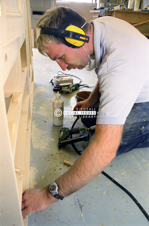 Man with learning disability doing woodwork,