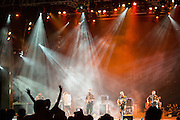 A concert goer waves at the end of the concert by Trampled by Turtles.