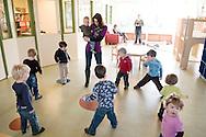 """Nederland, Herpen, 20090128...Dansen in de kring...Kinderopvang 'Op de boerderij' in Herpen...""""OP DE BOERDERIJ"""" kinderopvang..is gevestigd bij een vleesveebedrijf te Herpen...Dansen in de kring....Netherlands, Herpen, 20090128. ..Dancing in a circle. ..Childcare on the farm in Herpen. ..""""ON THE FARM"""" childcare ..is located at a beef farm in Herpen...Dancing    .."""