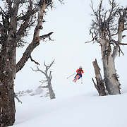 Tigger Knecht finds some mini-golf airs along his descent of winter storm powder at JHMR.