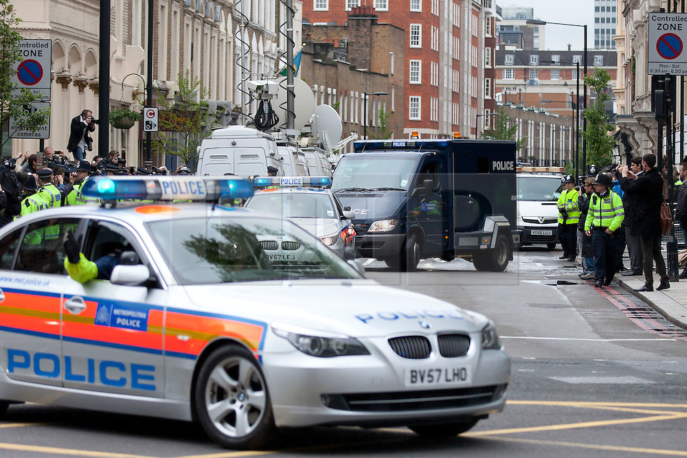© Licensed to London News Pictures. 30/05/2013. London, UK. The police van carrying Michael Adebowale, one of two men charged with killing Drummer Lee Rigby in Woolwich last week, is seen leaving at Westminster Magistrates in London today (30/05/2013) with an armed police escort. Photo credit: Matt Cetti-Roberts/LNP