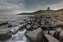 Storm clouds start to roll in ahead of storm Ophelia on the Northumberland coast near Dunstanburgh Castle.