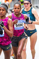 NYC Marathon, Firehiwot Dado, Ethiopia, tucks behind her countrywoman Buzunesh Deba in the lead group of women on First Avenue
