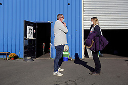 18 November 2020. Care4Calais - Calais, France.<br /> Daily Mirror chief reporter Andy Lines interviews Claire Moseley, founder of the volunteer run migrant charity Care4Calais warehouse near Calais. Claire's charity provides meals, clothing, haircuts, charging stations for phones, hot drinks, tents, blankets and a wide range of goods and services to help migrants struggling to survive on the streets of Calais where they are continually harassed and moved on by authorities. <br /> Photo©; Charlie Varley/varleypix.com