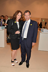 POJU & ANITA ZABLUDOWICZ at the Masterpiece Marie Curie Party supported by Jeager-LeCoultre held at the South Grounds of The Royal Hospital Chelsea, London on 30th June 2014.