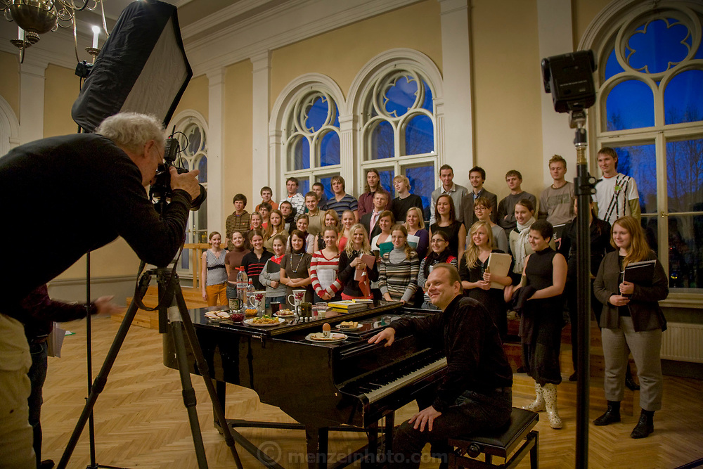 Peter Menzel, photojournalist and co-author of the book, What I Eat: Around the World in 80 Diets, photographs voice coach Ansis Sauka and the Kamer Latvian youth choir in Riga, Latvia. (From the book What I Eat: Around the World in 80 Diets.)