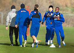 © London News Pictures. 30/11/2012. London, UK. Samba Diakite and Ji-Sung Park (right) with the QPR Squad during training with QPR team  at the QPR training ground in Harlington, Wes London. Photo credit: Ben Cawthra/LNP