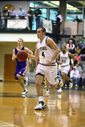 30 December 2006: Mike Harrigan takes advantage of a fast break. The Titans outscored the Britons by a score of 94-80. The Britons of Albion College visited the Illinois Wesleyan Titans at the Shirk Center in Bloomington Illinois.<br />