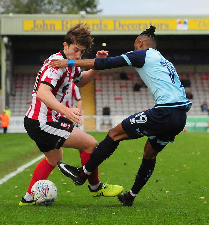 Lincoln City's Alex Woodyard vies for possession with Crawley Town's Cedric Evina<br /> <br /> Photographer Chris Vaughan/CameraSport<br /> <br /> The EFL Sky Bet League Two - Lincoln City v Crawley Town - Saturday 28th October 2017 - Sincil Bank - Lincoln<br /> <br /> World Copyright © 2017 CameraSport. All rights reserved. 43 Linden Ave. Countesthorpe. Leicester. England. LE8 5PG - Tel: +44 (0) 116 277 4147 - admin@camerasport.com - www.camerasport.com