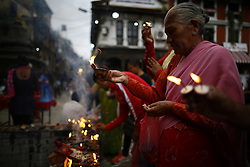 August 16, 2017 - Lalitpur, Nepal - Devotees light butter lamps to worship God Bhimsen inside Patan Durbar Square, a UNESCO World Heritage Site during Bhimsen festival in Lalitpur, Nepal on August 16, 2017. Deity Bhimsen is worshipped in belief of prosperity to ones business. (Credit Image: © Skanda Gautam via ZUMA Wire)