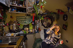 """Scarlett J. Sullivan, who performs as a clown in the show, relaxes in her room onboard the train between performances in Washington D.C. <br /> <br /> Ringling Bros. and Barnum & Bailey Circus started in 1919 when the circus created by James Anthony Bailey and P. T. Barnum merged with the Ringling Brothers Circus. Currently, the circus maintains two circus train-based shows, the Blue Tour and the Red Tour, as well as the truck-based Gold Tour. Each train is a mile long with roughly 60 cars: 40 passenger cars and 20 freight. Each train presents a different """"edition"""" of the show, using a numbering scheme that dates back to circus origins in 1871 — the first year of P.T. Barnum's show."""