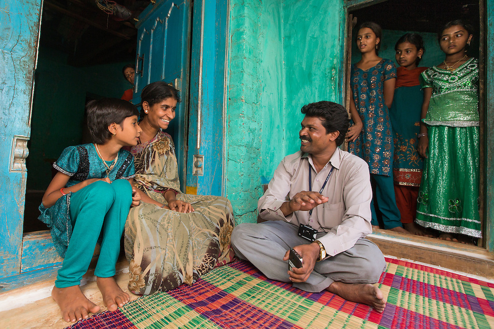 CAPTION: Gathering community data. Mobility India and CBM have partnered with Aptivate to develop a simple means of collecting key project-relevant data using relatively unsophisticated mobile phones. LOCATION: Sappayyanapura (village), Kasaba (hobli), Chamrajnagar (district), Karnataka (state), India. INDIVIDUAL(S) PHOTOGRAPHED: From left to right: Rakshitha S. V., Bhagya, P. Murthy, Shilpa C.B., Kavya S.N. and Manjula; background: Mahadevamma.