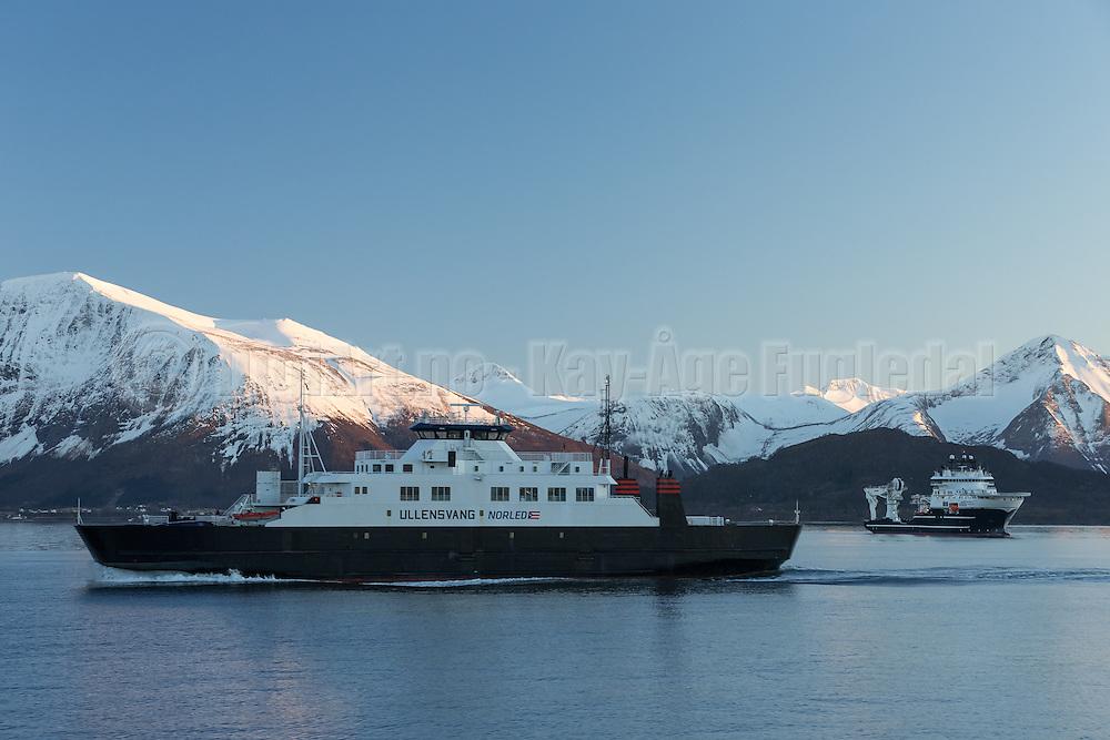 Ferry sailing in Norwegian fjord, with snowy mountains in the background   Ferga Ullensvang seiler i Sulafjorden på Vestlandet, med snøkledde fjell og offshore fartøyet Grand Canyon II i bakgrunnen.