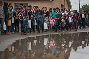Central American asylum seekers arrive at a Catholic Charities respite center in McAllen, Texas, U.S., March 20, 2019. The migrant families passing through the respite center continue on to various parts of the country, where they await future court dates to determine whether they'll be permitted to stay in the U.S.