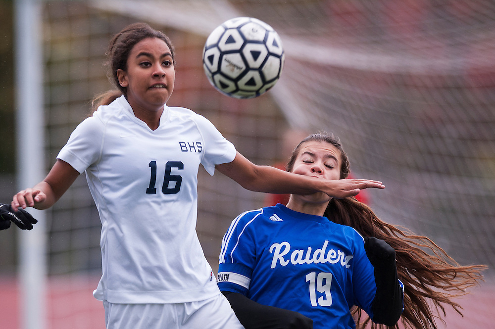 Burlington's Tatum Vachereau (16) battles to head the ball with U-32's Tehya Weston (19) during the girls playoff soccer game between the U-32 Raiders and the Burlington Sea Horses at Buck Hard Field on Friday afternoon October 24, 2014 in Burlington, Vermont (BRIAN JENKINS, for the Free Press)