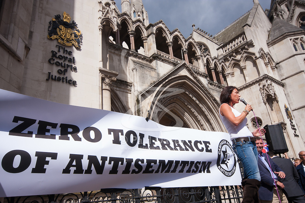"""Royal Courts of Justice, London,  August 31st 2014. Jewish activist Mandy Blumenthal speaks as thousands of Jews and their supporters from London and across the UK demand """"Zero Tolerance for Antisemites"""", organised by the Campaign Against Antisemitism."""