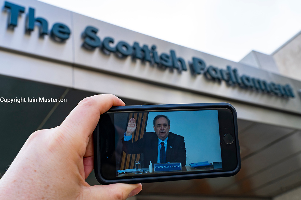 Edinburgh, Scotland, UK. 26 Feb 2021. Live streaming outside parliament of Alex Salmond taking the oath at committee on the Scottish government handling of harassment complaints today at Scottish Parliament in Holyrood , Edinburgh. Iain Masterton/Alamy Live News