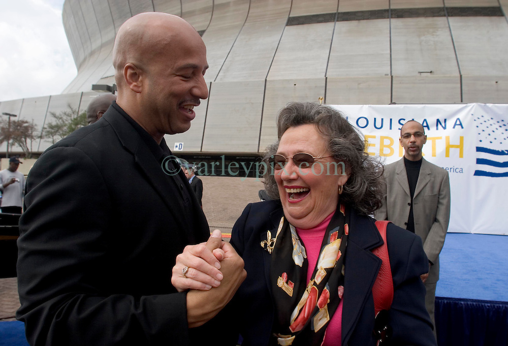 1st January, 2006. New Year's Day in New Orleans, Louisiana. Louisiana Rebirth interfaith service at the Superdome rings out the old disasterous 2005 and rings in what politicians and locals hope will be a successful 2006.  Mayor Ray Nagin shares a New Year joke with councillor Jackie Clarkson.<br /> Photo; Charlie Varley/varleypix.com