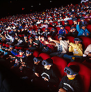 Children at the Sony IMAX Theater in New York City experience an eight story high film screen in 3 dimensions with the aid of liquid crystal headsets that blink 48 times a second.