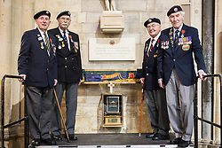 © Licensed to London News Pictures. 14/03/2017. York UK. (left to right) the four remaining members of the York branch Normandy Veterans Association, 91 year old Ken Cooke, 92 year old George Meredith, 91 year old Albert Barritt & 92 year old Ken Smith. The last four members of the York branch of the Normandy Veterans Association have attended a service today at York minster as part of a special memorial to lay-up their standard in it's final resting place in the minster & to all who served in the Normandy campaign in 1944. The standard has been placed in it's case in the North Transept of the minster by Kenneth Smith who was part of the Duke of Cornwall's Light Infantry and landed in Normandy on D-Day June 1944 aged just 19 years old. Mr Smith was joined by the remaining three members of the York branch - Ken Cooke, 91, Albert Barritt, 91 and George Meredith, 92 - and their families for the service. All four veterans were awarded the Legion d'Honneur, France's highest military honour, in May 2016. Photo credit: Andrew McCaren/LNP