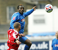 Photo: Chris Ratcliffe.<br />Leyton Orient v Grimsby Town. Coca Cola League 2. 17/04/2006.<br />Jean-Paul Kalala (R) of Grimsby goes up for a header above Donny Barnard of Leyton Orient