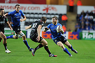 Leinster's Gordon D'Arcy ® looks to go past Dan Biggar. Heineken cup rugby, pool 1 match, Ospreys v Leinster rugby at the Liberty stadium in Swansea on Sat 12th October 2013 pic by Andrew Orchard, Andrew Orchard sports photography,