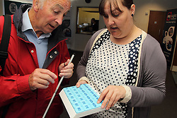 Demonstration of raised-letters pill box at the Mysight charity for people with visual impairments.