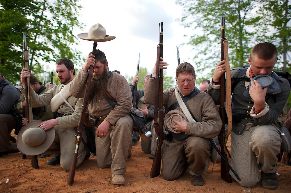 Confederate soldiers pray after recreating the death of General Stonewall Jackson during the Chancellorsville 150th reenactment in Spotsylvania, VA on May 4, 2013.