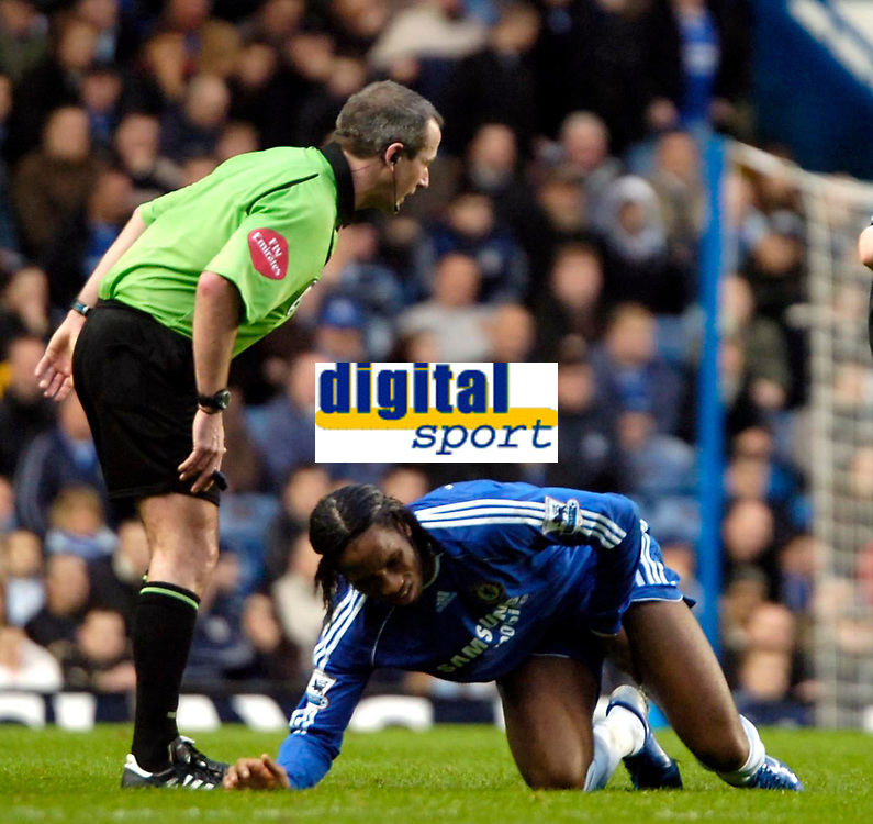 Photo: Ed Godden/Sportsbeat Images.<br />Chelsea v Wigan Athletic. The Barclays Premiership. 13/01/2007. Chelsea's Didier Drogba lies in pain.