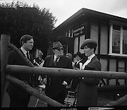 The Bollinger Bar at Phoenix Park..1972..07.10.1972..10.07.1972..7th October 1972..As part of the Phoenix Park races Bollinger opened a bar to facilitate the Champagne tastes of the racegoers...Pictured at The Bollinger Champagne Bar, Mr Tom Whelehan,Director,Irish Vitners Ltd, Mr Tom McCairns,racehorse owner and Mrs Tom Whelehan