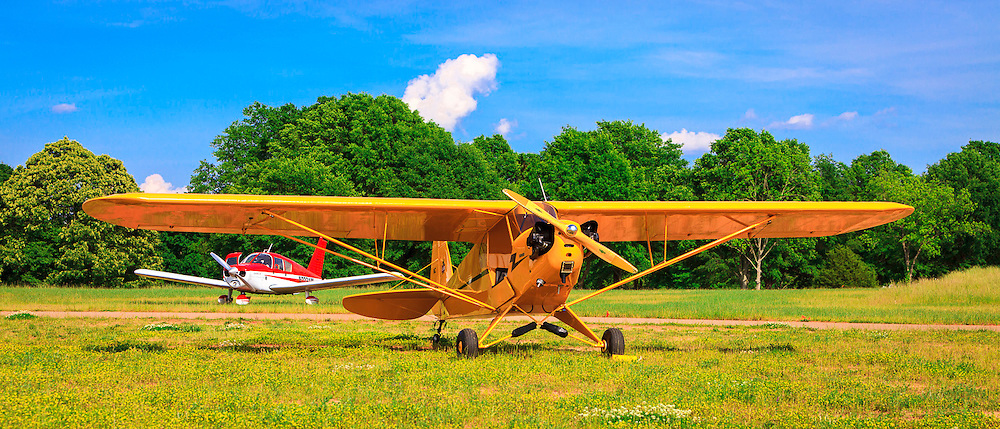 A 1946 Piper J3 Cub, and a Piper Cherokee at Peachstate Aerodrome, in Williamson, Georgia.