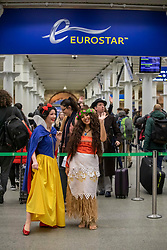 © Licensed to London News Pictures. 20/12/2019. Snow White and Moana entertain passengers to Disneyland Paris as the Christmas Getaway starts at St Pancras Station. Heavy rain today is causing chaos for the  thousands who are expected to travel for the festive period: Alex Lentati/LNP